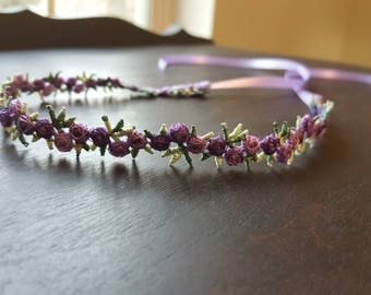 Flower crown with purple flowers and purple ribbon