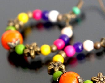 Colorful hoop earrings with howlite beads.