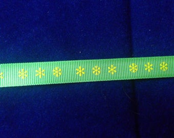Spring green grosgrain ribbon with a pretty yellow flower design. 15mm wide