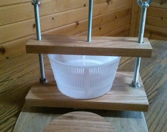 Solid oak cheese press made in Michigan 40 # of force.