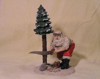 Santa Cutting Tree Christmas Decor (1990)
