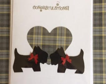 Two black scottie dogs on heart background