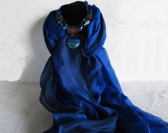 Bluette and blue scarf.