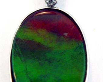 Large Rainbow Ammolite and Diamond Pendant set on 14k White Gold.