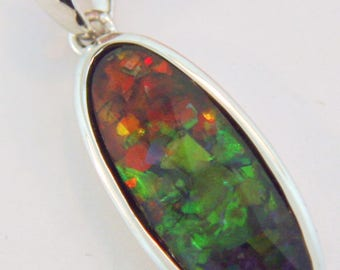 Long Oval Shaped  Canadian AAA Quality Ammolite Pendant set in  Sterling Silver.