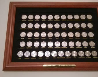 50 state Quarters in a frame.  All coins in brillant uncirculated condition.  Beautiful!