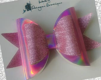 Iridescent pink bow