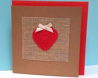Handmade card with a crocheted red heart