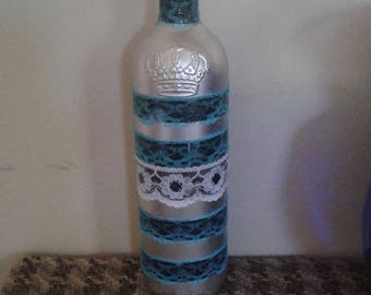 Christmas wine bottle  vase  as a   centerpiece  as well as on the  mantelpiece or a vase for artificial flowers