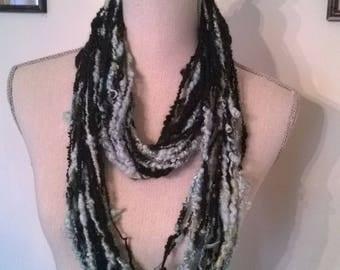 Core spun art yarn or scarf