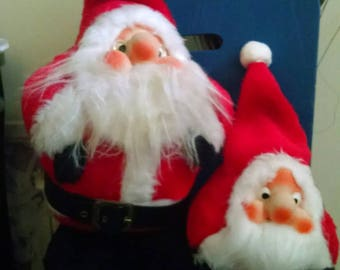 1980 plush Santa Clauses their faces are rubber