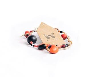 Pionias and blanco peace bracelet