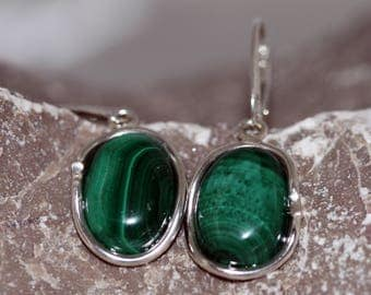Malachite Earrings. Wonderful, perfectly oval pieces of Malachite in a sterling silver setting. Handmade & unique.