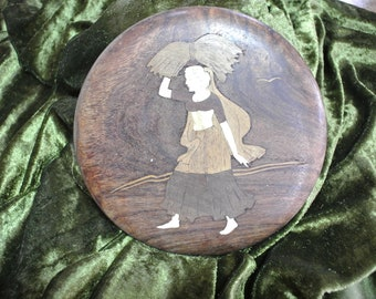 Example of marquetry, a peasant woman carrying hay