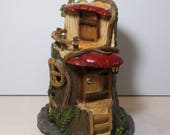 On sale was 14.95.  Miniature garden Tree house: Fairy, gnome, terrarium house