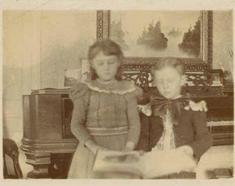 vintage photo 1906 Children Eyes Closed Looks at song Book Harpsichord Piano in back