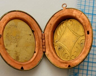 Locket. Vintage brass and copper. Large oval locket.