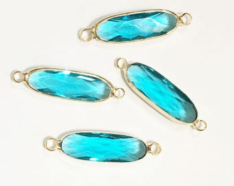 4 pcs Glass faceted oval with  brass setting 27x7mm Zircon blue , glass connector 1/1 loop with  brass setting, long oval connector