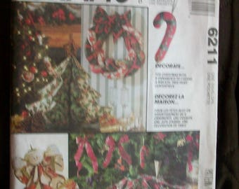 McCalls Crafts 6211   Christmas ornaments, a wreath, tree skirt, and centerpiece sewing pattern