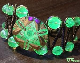 Bracelet featuring rare green Czech vaseline uranium glass with dragonflies