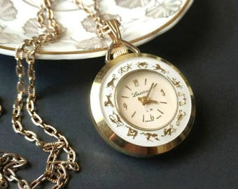 Vintage pocket watch necklace Lucerne astrology zodiac gold tone white floral flowers Swiss made
