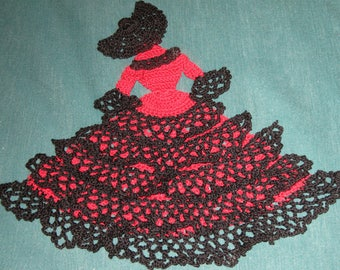 Crinoline Lady doily, red and black, ruffled skirt