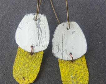 White and yellow earrings in modern shapes