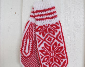 Handknitted wool mittens with norwegian pattern in white and red