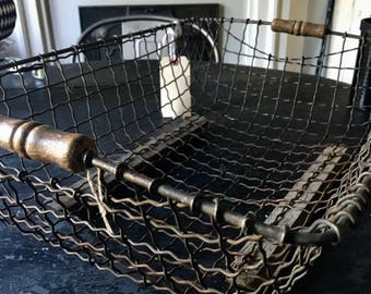 Antique Wire basket, wood runners and handles.