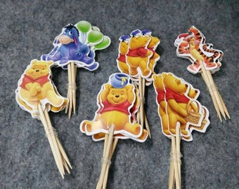 24 piece Winnie the pooh cupcake topper. 1-1/2 inches round. Double sided