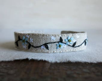Natural Linen Embroidered Cuff Bracelet - Light Blue Flowers and a Black Vine Embroidered on Natural Linen Cuff Bracelet