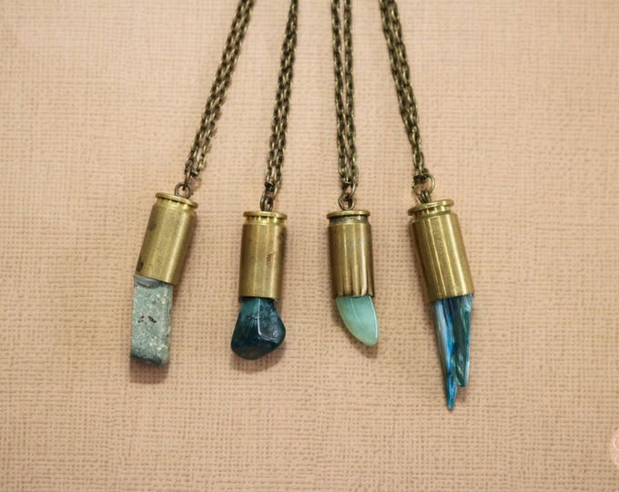 Evergreen Winter collection crystal bullet necklaces.