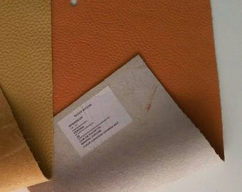 Peachy orange leather scrap