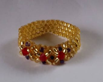 Baroque style gold ring with red swarovski glass beads