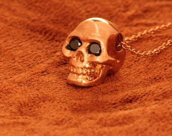 Solid  Rose Gold Tiny black diamond eyed human skull pendant made in NYC Blue Bayer Design