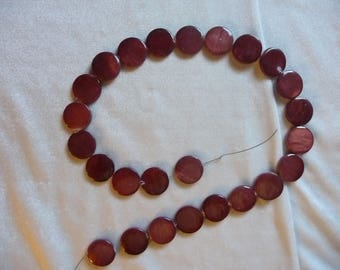 Beads, Mother of Pearl, 15mm Flat Round Coin, Rust Color. Sold per 15 inch strand. There are 25 beads on the strand.