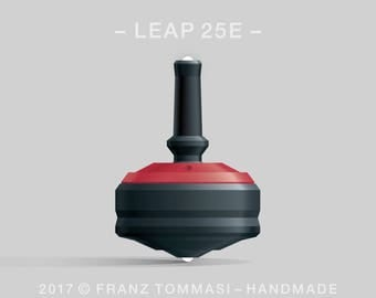 LEAP 25E Red-on-Black Spin Top with red cover over black body, ergonomic stem with rubber grip, dual ceramic tip, and 3 accent holes