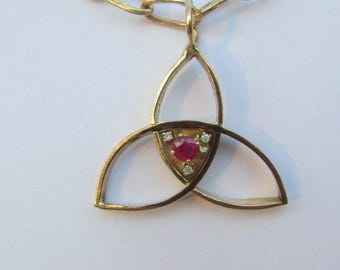 Pendant- Triquetra (Trinity symbol) in 14 K Gold, Natural Ruby and Diamonds