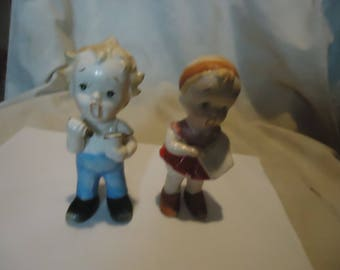 Vintage Japan Ceramic Young Boy and Girl Singing or Yawning Figurines, collectable