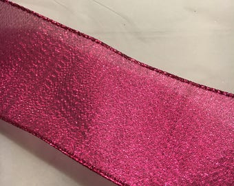 Pink shimmering ribbon w/wired edge 2.5 inches wide, each roll is 25 ft. long