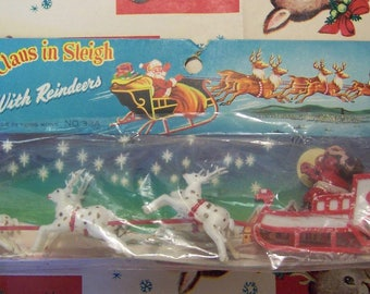 santa claus in sleigh with reindeer