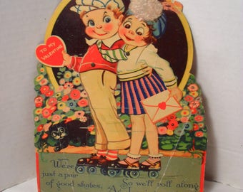 Antique Mechanical or Pivot Moving Eyes Roller Skating Boy and Girl Valentine's Day Card or Decoration