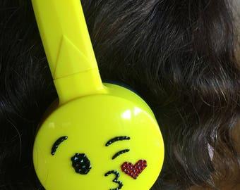 Swarovski encrusted Kiss emoji headphones