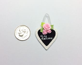 Dollhouse shop welcome sign with pink roses in 1:12 scale