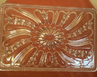 A vintage Art Deco cut glass tray from a vanity set.