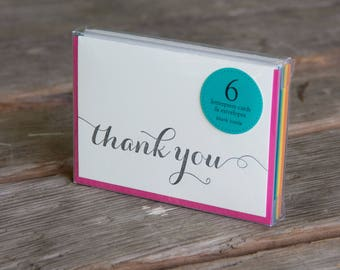 6 pack thank you letterpress cards, in orange or black letterpress printed card. Eco friendly