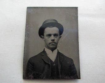 antique small tintype photo - 1800s, man with hat, stick out ears
