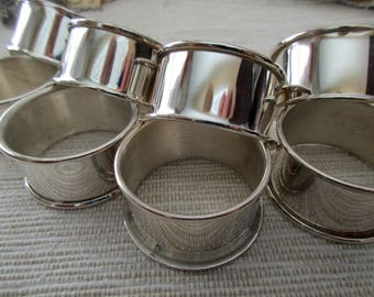 8 vintage silver plated round napkin rings