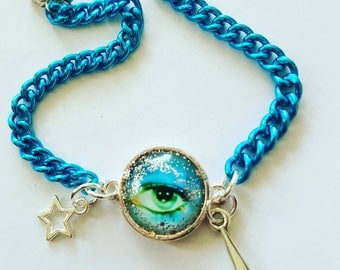 David Bowie 16mm cabochon Stardust Eye with turq chain bracelet.