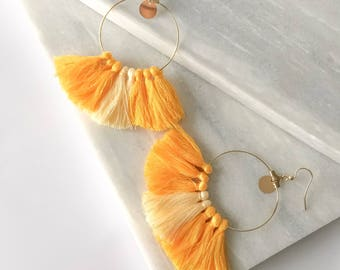 Hoop earrings with yellow PomPoms